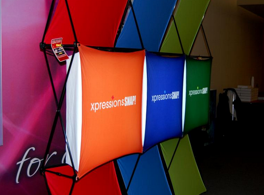 xpressions backlit fabric pop up display graphic skins